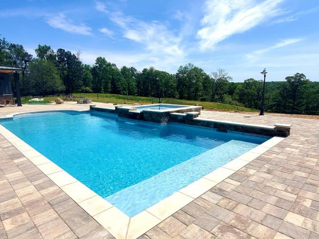 Custom gunite pool with radius steps